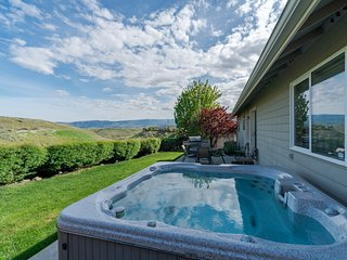 Sleepy hillside home features private hot tub and great location!
