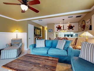 Coastal condo w/shared pool near deck and dining, close to beach!