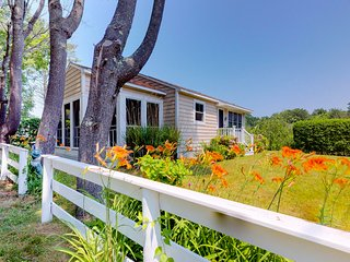 NEW LISTING! Charming cottage w/pleasant outdoor space, short walk to the beach