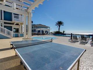Dog-friendly beachfront condo with views & beach access, pools & hot tub!