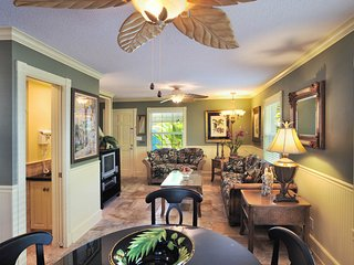 Romantic dog-friendly cottage w/shared pool, tropical decor, & easy beach access