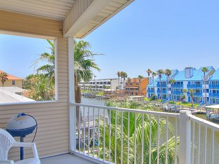 Waterfront condo with pool, dock access & panoramic views