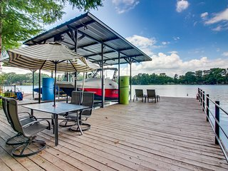 Lakeside home w/ a dock, putting green, patio, game room, & views