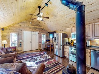 NEW LISTING! Riverside cabin w/private hot tub, wood stove, deck & river views