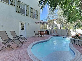 Luxurious dog-friendly home with a private pool, back patio, and balconies
