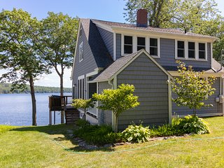 Rustic lakefront home w/ private dock, wood fireplace & modern conveniences