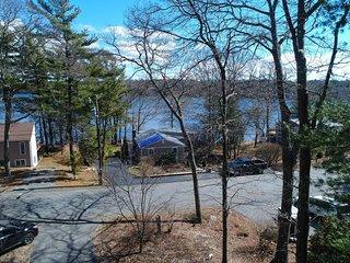 Lakefront lodge w/ elegant design, views, a private hot tub, firepit & balcony!