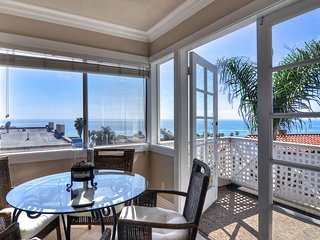 New listing! Four condos in the same building, just one block from beach & pier!