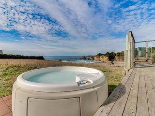 Dog-friendly home w/ private beach access, hot tub, & stunning views