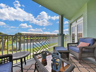 NEW LISTING! Waterfront condo w/ balcony, shared pool, views-walk to the beach