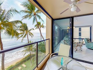 Stunning beachfront condo w/private lanai, sea views, shared hot tub, and pool