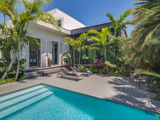 NEW LISTING! Gorgeous modern home with private pool near beach, fishing and more
