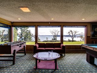 Bayfront home with a fitness room, fun-filled game room, & more!