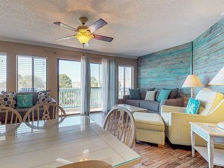 NEW LISTING! Amazing coastal condo with shared pool and location close to beach!
