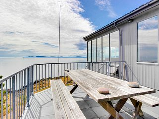 Open-concept waterfront getaway with stunning views of the Salish Sea!