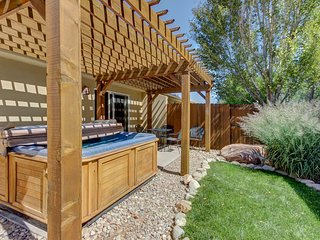 A private hot tub & shared pool await from this centrally located home!
