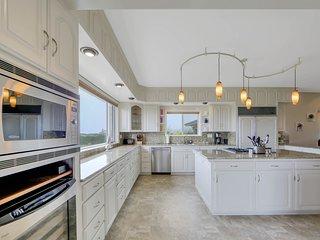 Luxurious home w/ game room, private hot tub, & ocean views!