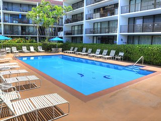 NEW LISTING! Ocean view condo w /lanai, shared pool/grills - steps to the beach!