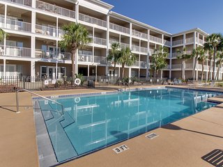 Beach condo with shared pool access, patio, free WiFi, full kitchen, and more