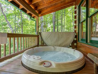 Dog-friendly cabin with a private hot tub, fenced yard, and a peaceful location!