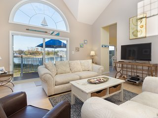 NEW LISTING! Waterfront townhome w/deck, sunroom, amazing bay view & shared pool