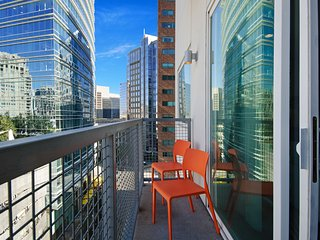 NEW LISTING! Modern retreat right downtown w/ shared pool & private washer/dryer