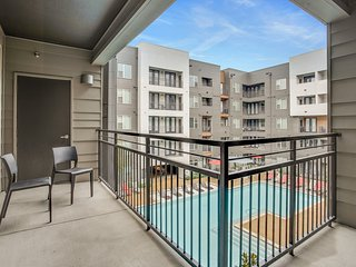 Modern condo with a shared pool, fitness room, walk to dining!