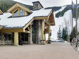 Waterfront condo with shared pool- one-minute walk to ski lifts!