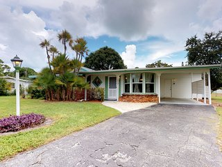 NEW LISTING! Retro home w/screened-in patio -near beaches, dining, shopping!
