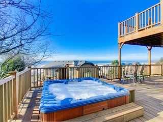 Enjoy gorgeous ocean view decks, a private hot tub & a well-stocked game room!