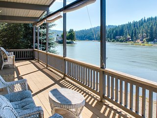 Cozy lakefront cottage w/ a wraparound deck, gorgeous view, private dock, & more