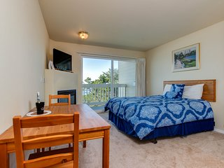 Romance awaits with ocean views & sandy shores at this dog-friendly room!