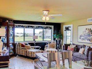 Stylish condo w/ water views, shared pool, tennis, & dock - snowbirds welcome!