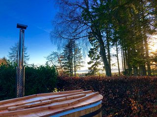 Wood burning hot tub outside your cottage, views of the Tay in the distance