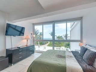 Oceanfront 2-story condo w/direct beach access off patio & shared pool!