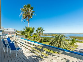 Waterfront dog-friendly home with shared pool and sweeping  views