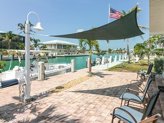 Waterfront home w/35-foot dock & access to private beach & shared pool