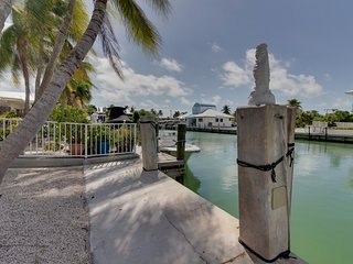 Waterfront home w/24 foot dock and shared pool & beach access!