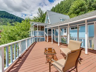 Multi-level riverfront home w/dock welcomes families, groups, & dogs!