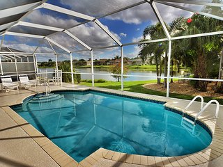 Spacious lakefront home w/ a screened-in pool in exclusive community