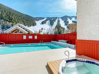Ski-in/ski-out alpine condo with shared seasonal pool, hot tub, sauna, & views