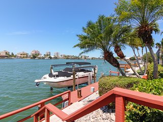 Waterfront ranch home w/ dock and a screened-in pool. Just minutes to beaches!