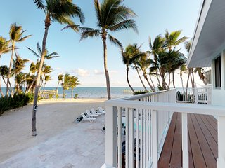Dog-friendly, waterfront home w/ a private pool, hot tub, & private beach