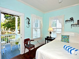 Upper-floor suite in historic home w/ shared on-site pool & semi-private veranda