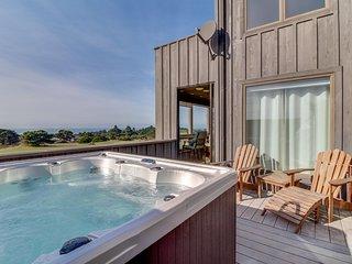 Enjoy decks, ocean views, private hot tub  & shared pool/sauna by golf & trails!