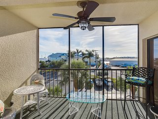 2nd-story waterfront condo w/ shared pool & hot tub and private balcony w/view
