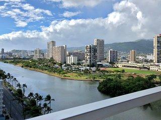 Waterfront condo w/ shared pool & hot tub plus mountain, city, & golf views