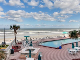 Beachfront condo w/ balcony & ocean view plus shared pool, hot tub, & game room