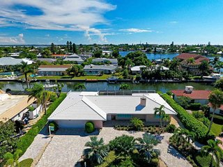 Beautiful waterfront home w/ screened & furnished lanai, private pool, & dock