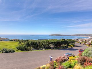 Elegant golf course home w/ hot tub, deck & ocean view - close to town, beaches!